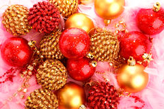 Christmas baubles on pink feather Royalty Free Stock Photo