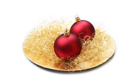 Christmas baubles on plate, isolated. Royalty Free Stock Image