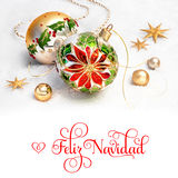Christmas baubles with poinsettia on snow, text Royalty Free Stock Photography