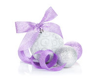 Christmas baubles and purple ribbon Stock Image