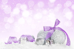 Christmas baubles and purple ribbon Royalty Free Stock Image