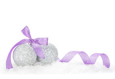 Christmas baubles and purple ribbon Stock Images