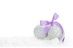Christmas baubles and purple ribbon Royalty Free Stock Photo