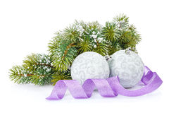 Christmas baubles and purple ribbon with snow fir tree Stock Images
