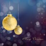 Christmas baubles. Realistic Christmas baubles hanging over blurred background Stock Photo