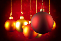 Christmas baubles on red background Royalty Free Stock Photography