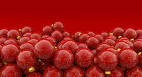Christmas baubles on red background. Heap of christmas baubles on red background Royalty Free Stock Photo