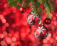 Christmas Baubles on red background. Stock Photo
