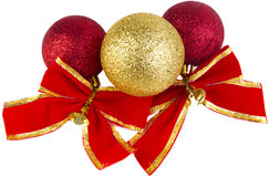 Christmas baubles with red bows. Red and gold christmas baubles with bows and gold bells isolated on a white background Royalty Free Stock Image