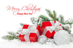 Christmas baubles and red gift boxes with snow fir tree Stock Photo