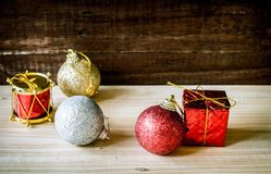 Christmas baubles red gold silver on table. Christmas baubles red gold silver on wood table Royalty Free Stock Photo