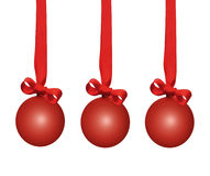 Christmas baubles. Red christmas baubles with ribbon bows over a white background Stock Image