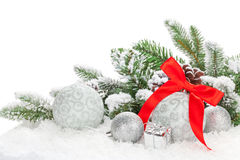 Christmas baubles with red ribbon and fir tree Royalty Free Stock Image