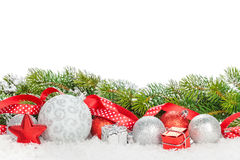 Christmas baubles and red ribbon with snow fir tree Stock Images