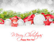 Christmas baubles and red ribbon with snow fir tree Stock Photo