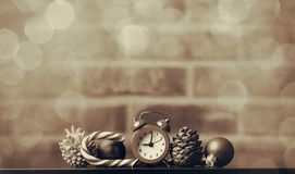 Christmas baubles with retro alarm clock Stock Photos