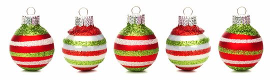 Christmas baubles in a row isolated. Red, green and white Christmas baubles in a row isolated on white Royalty Free Stock Photo