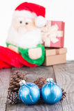 Christmas baubles and Santa Claus toy background Royalty Free Stock Image
