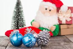 Christmas baubles and Santa Claus toy background Stock Photos