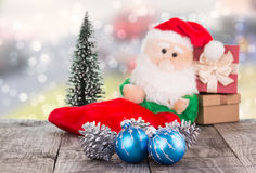 Christmas baubles and Santa Claus toy Royalty Free Stock Images