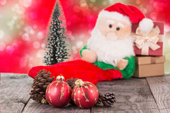 Christmas baubles and Santa Claus toy Stock Images