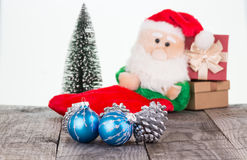 Christmas baubles and Santa Claus toy Stock Photos