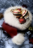 Christmas baubles in Santa hat Royalty Free Stock Photos