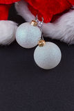Christmas baubles and Santa hat Stock Image
