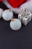 Christmas baubles and Santa hat Royalty Free Stock Photos