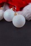 Christmas baubles and Santa hat Royalty Free Stock Photo