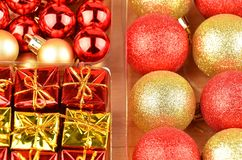 Christmas baubles set. Set of red and golden Christmas gift baubles Royalty Free Stock Image
