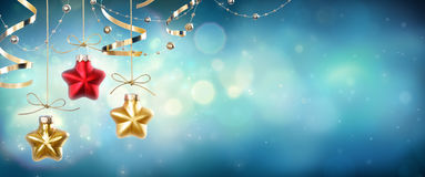 Christmas Baubles Shape Star Hanging. In Shiny Night Stock Photo