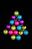 Christmas baubles in the shape of a tree. Stock Photos