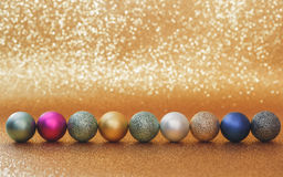 Christmas baubles on shiny background Royalty Free Stock Images