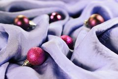 Christmas baubles on a silk background Royalty Free Stock Image