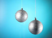 Christmas baubles. Silver Christmas baubles on blue background Stock Images