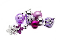 Christmas baubles. Silver Christmas baubles on blue background stock photos