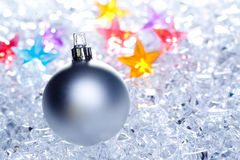 Christmas baubles silver on winter ice Royalty Free Stock Images
