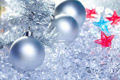 Christmas baubles silver on winter ice Royalty Free Stock Photography