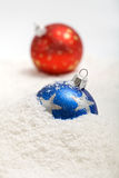 Christmas baubles in snow Stock Images