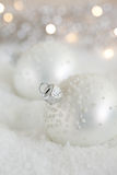 Christmas baubles in the snow Stock Photo