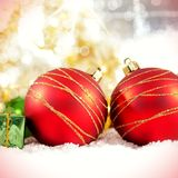 Christmas baubles in snow Royalty Free Stock Images