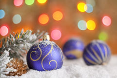 Christmas baubles on snow Stock Image