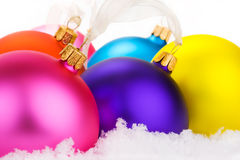 Christmas baubles in the snow Stock Images