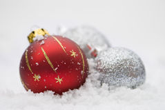 Christmas Baubles In The Snow Stock Photography