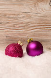 Christmas baubles on snow Stock Images
