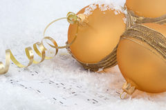 Christmas baubles on snow Stock Photos