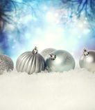 Christmas baubles on the snow. Silver Christmas baubles on the snow in the night Stock Image