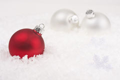 Christmas baubles in the snowflake garland Royalty Free Stock Photography