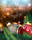 Christmas baubles with sparkles and fir branches. Abstract holiday background with sparkles, Christmas balls and fir branches Stock Images